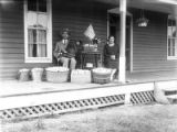 Man and woman on front porch with wares
